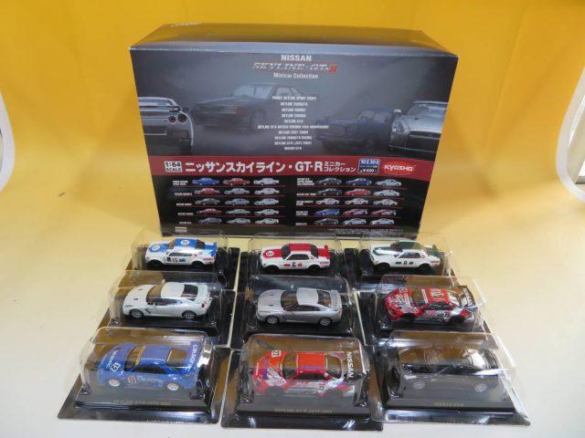 「京商 ニッサンスカイライン・GT-R ポルシェミニカーコレクション」などミニカーや車関連書籍を多数買取ました。